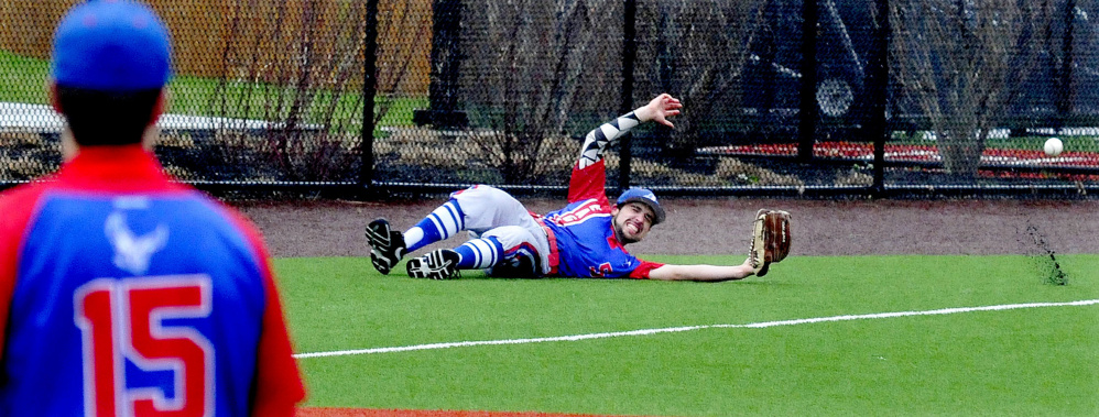 Messalonskee's Noah Tuttle slides to try and catch a ball during a game against Lawrence on Monday at Colby College.
