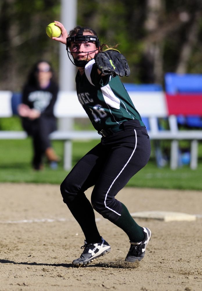Carrabec shortstop Paige Giroux throws to first after fielding a grounder against Monmouth on Tuesday in Monmouth.