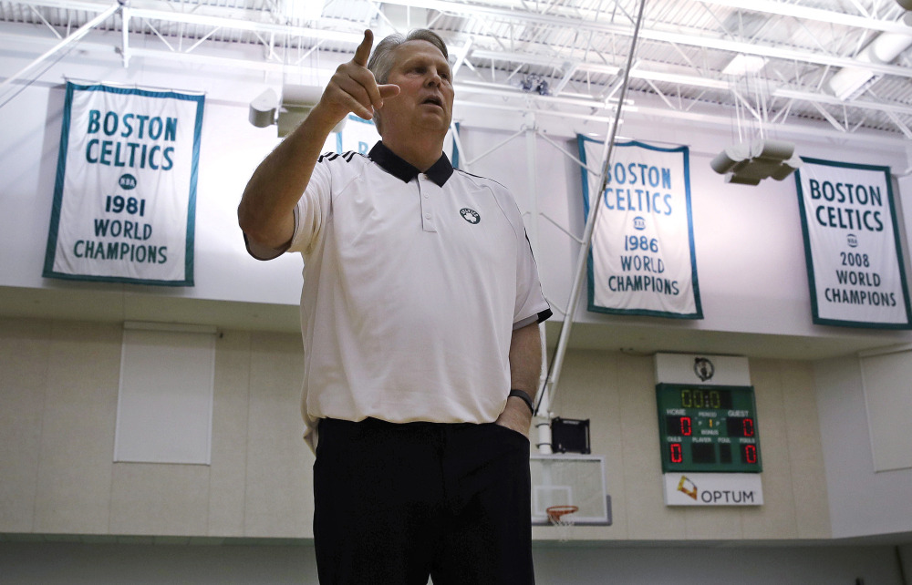 Danny Ainge, Boston Celtics president of basketball operations, gestures as he passes the team's NBA championship banners st the team's training facility in Waltham, Massachusetts on Tuesday. The Celtics had won the NBA draft lottery, capitalizing on a trade they made with the Brooklyn Nets four years ago.