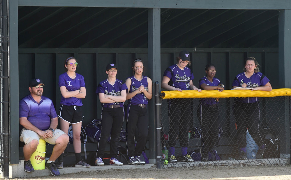 Members of the Waterville softball team watch the action against Medomak on Wednesday afternoon.