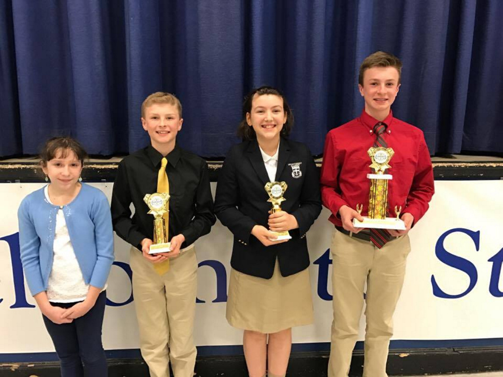 From left are Anna Whitstone, runner-up; Kameron Douin, third-place winner; Carolyn Kinney, second-place winner; and Kyle Douin, first-place winner.