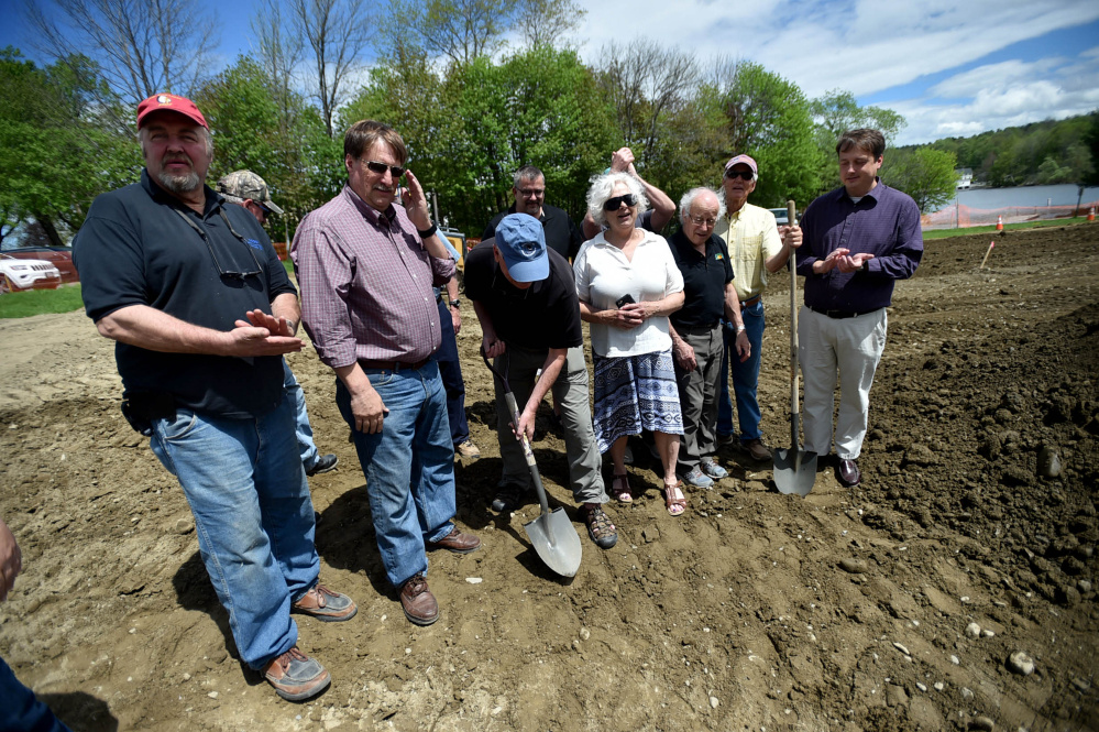 Mike Willey digs his shovel into the earth as members of the Oakland town council and gazebo committee break ground at the Messalonskee Lake boat launch for a new gazebo for community use on Friday.