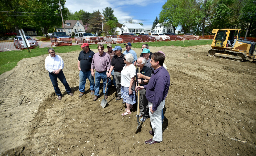 Members of the Oakland town council and gazebo committee break ground at the Messalonskee Lake boat launch for a new gazebo for community use on Friday.