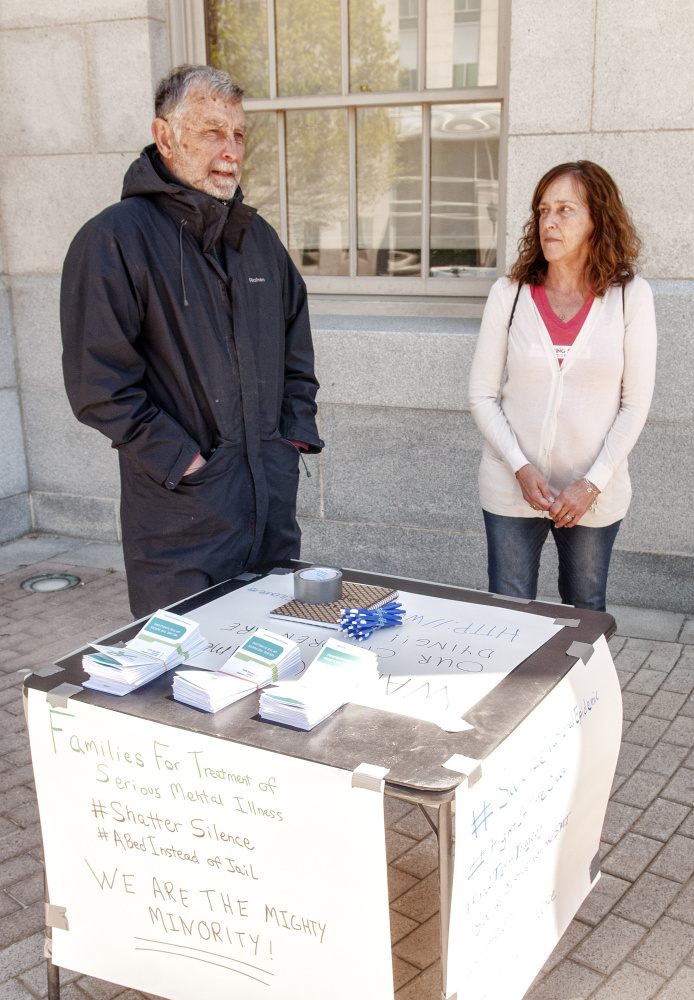 Chip Angell, of Brooklin, left, and Jeanne Gore, of Shapleigh, talk about mental health laws during an interview Saturday at the Maine State House in Augusta.