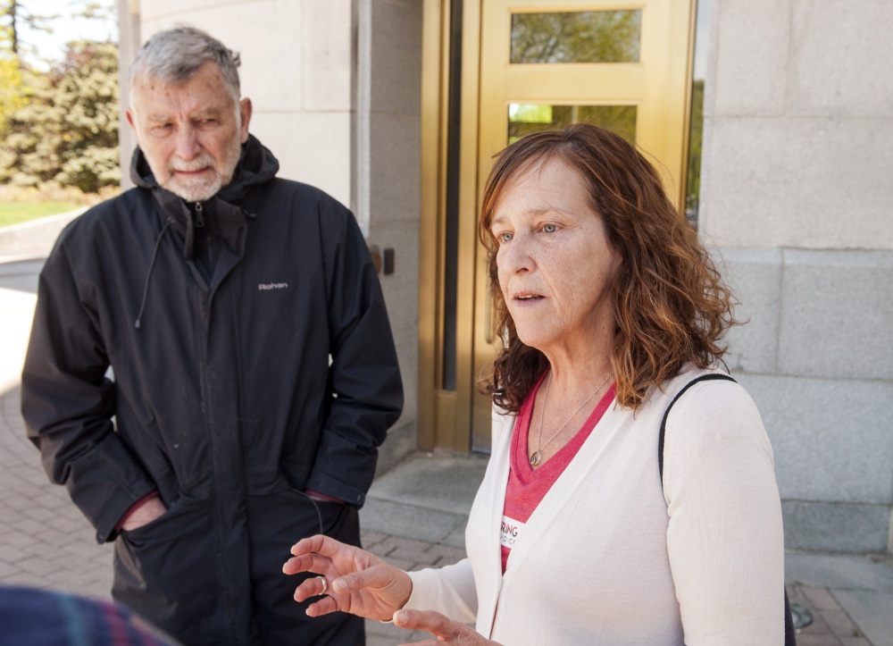 Chip Angell, of Brooklin, left, and Jeanne Gore, of Shapleigh, talk about mental health laws during an interview on Saturday at the Maine State House in Augusta.