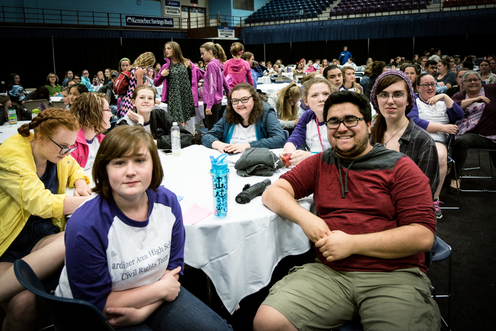 Gardiner Area High School students attend the Civil Rights Team Project at the Augusta Civic Center on Monday. Shown are: front, left to right, Melanie Mansir, 17, of South Gardiner; Lilly Lancaster, 17, of Randolph; Matteo Ortiz, 19; of Pittston; and Devon Hall, 18, of Gardiner. Back row, Lauren Mathews, 17, of Randolph, Brooke McLaughlin, 15; Jaime Frye, 15; and, Brooke Moloney, 17, all from Gardiner