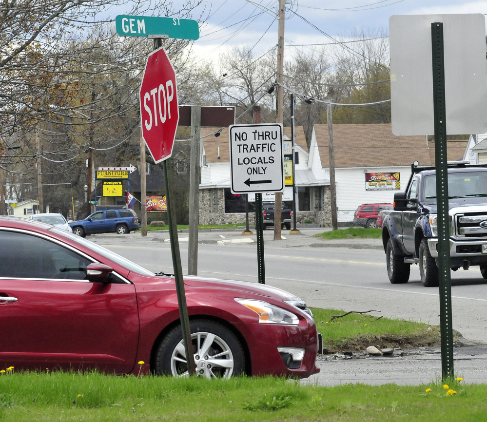 A motorist comes to a stop at the intersection of Gem Street and North Avenue in Skowhegan recently. A new sign tells drivers the roadway is closed to thru traffic but open for local residents on Gem Street. A public hearing at the Board of Selectmen's meeting Tuesday will focus on traffic problems in Skowhegan.