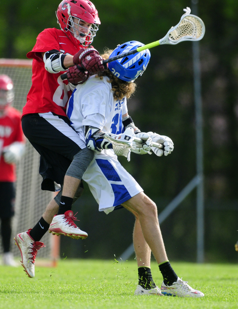 Cony's Cody Lamarre, left, defends Erskine's Grayson Petty during a Kennebec Valley Athletic Conference Class B game Tuesday in South China.