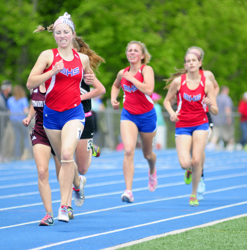 Messalonskee's Avery Brennan leads the 1,600 meter run at the Kennebec Valley Athletic Conference track and field championships Saturday at McMann Field in Bath.
