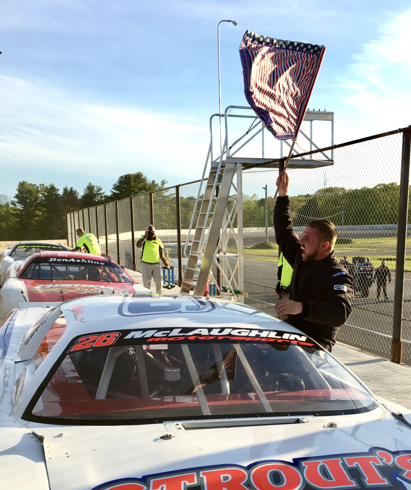 Staff photo by Travis Barrett   Andrew McLaughlin of Harrington celebrates his win in the Coastal 200 on Sunday at Wiscasset Speedway.