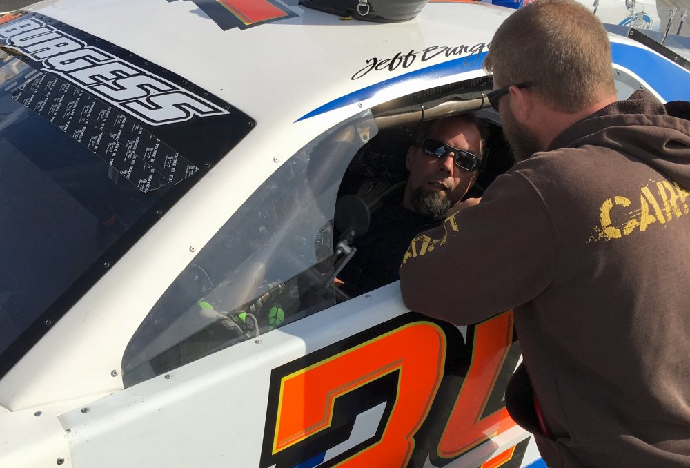 Staff photo by Travis Barrett   Jeff Burgess of East Madison gets buckled into his car prior to the start of the Coastal 200 on Sunday at Wiscasset Speedway.