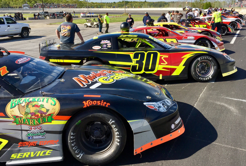 Staff photo by Travis Barrett   Cars line up on the frontstretch for driver introductions before the start of the Coastal 200 on Sunday at Wiscasset Speedway.