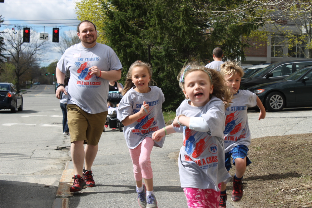 Johathan Irwin, left, with Kya Douin, Natalie Irwin and Eli Burnham during the St. Michael School and Travis Mills Walk-athon May 3, proceeds from the event will benefit the Travis Mills Foundation.