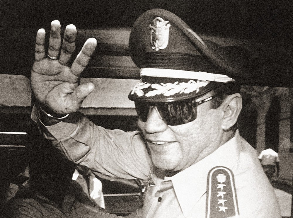 Gen. Manuel Antonio Noriega waves after a meeting at the presidential palace in Panama City on Aug. 31, 1989, when the state council named him president after he nullified the election.