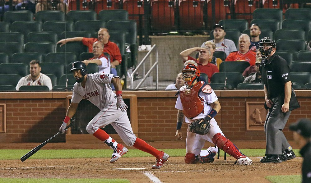 Boston Red Sox's Chris Young drives in the go-ahead run with a pinch-hit single in the 13th inning against the St. Louis Cardinals Wednesday night at Busch Stadium.
