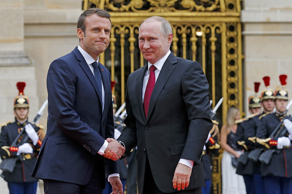 Russian President Vladimir Putin is welcomed by French President Emmanuel Macron at the Palace of Versailles, near Paris, Monday. Macron is the first Western leader to meet with Putin after the G7 Summit over the weekend where relations with Russia were a key part of the agenda.