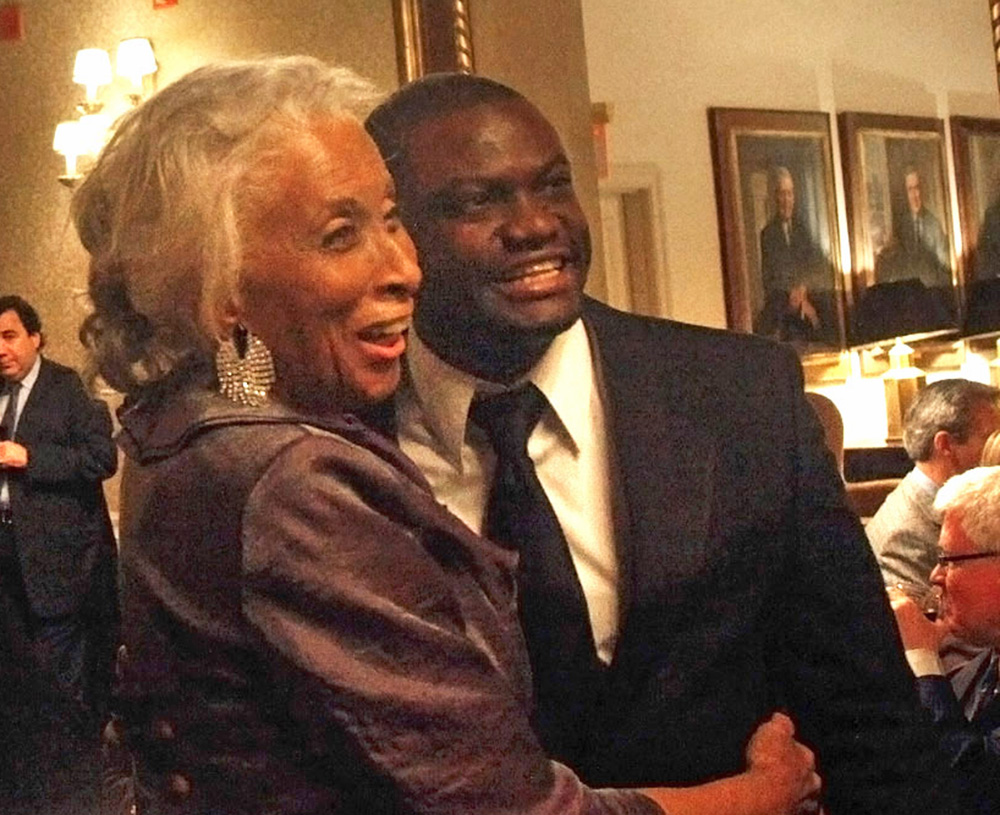 Barbara Smith Conrad hugs Nelson Hebo at a reception following his performance at Carnegie Hall in 2011.