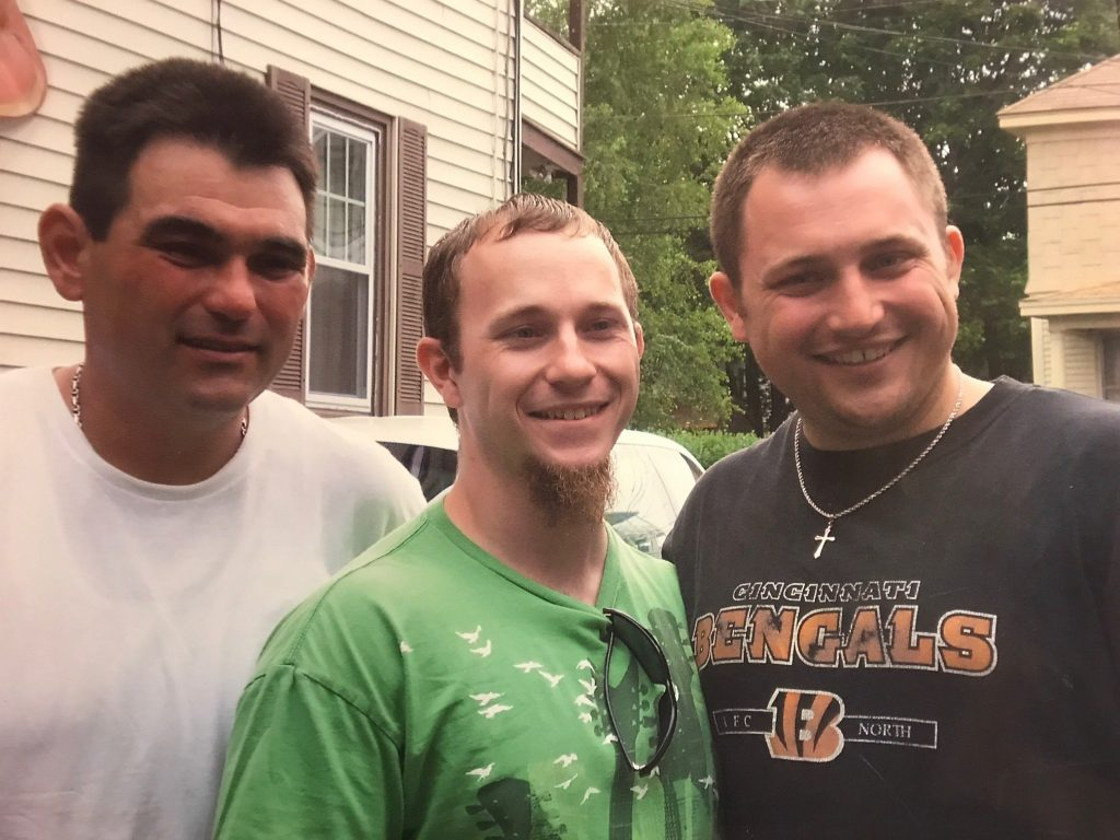 Jeffrey Lude, left, and his brothers Jared and Damian Renadette in 2013.