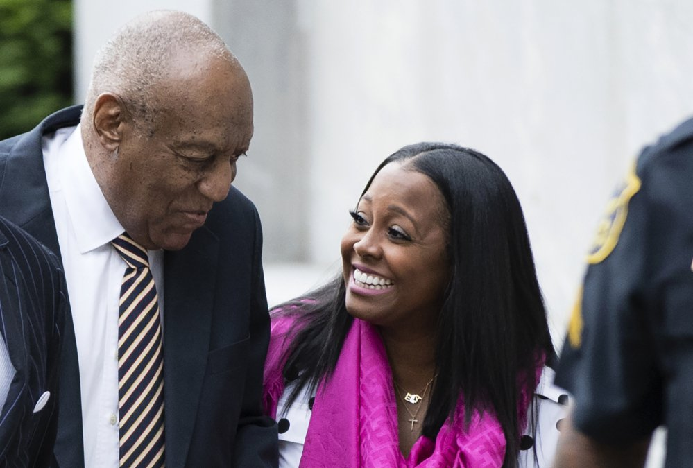 Bill Cosby arrives for his sexual assault trial with actress Keshia Knight Pulliam, right, at the Montgomery County Courthouse in Norristown, Pa., Monday. Pulliam played Cosby's youngest daughter, Rudy Huxtable, on