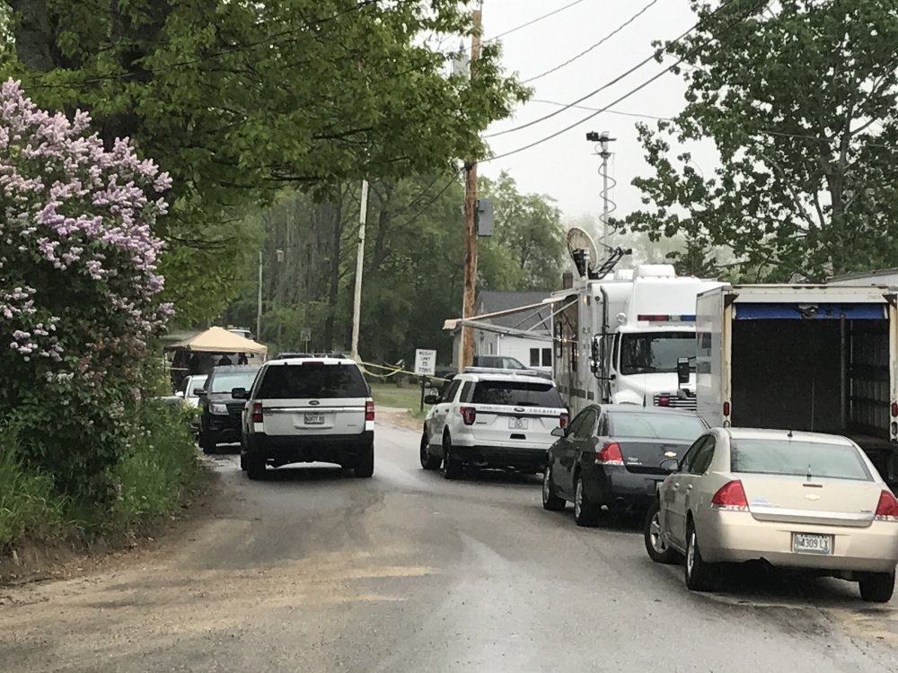 Police vehicles converge at Chad Dionne's home at Old Alfred Road in Arundel on May 29.