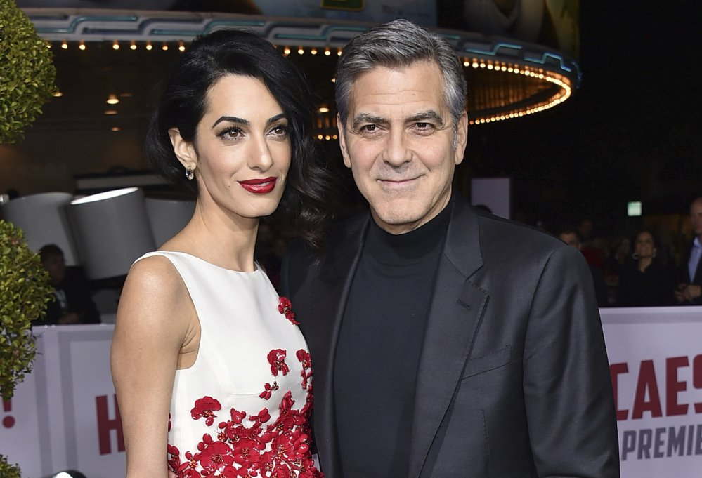 Amal and George Clooney, shown in February 2016, have become the parents of twins Ella and Alexander Clooney.