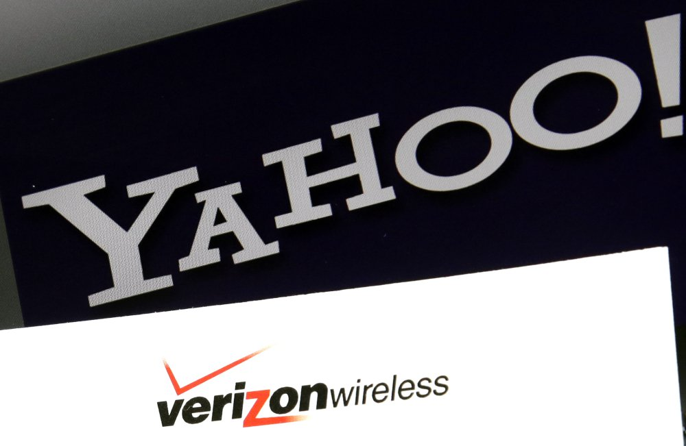 Photo shows Yahoo and Verizon Wireless logos on a laptop in North Andover, Mass. Verizon is buying Yahoo in hopes of challenging Google and Facebook in the digital advertising market by combining ad technologies and user profiles.