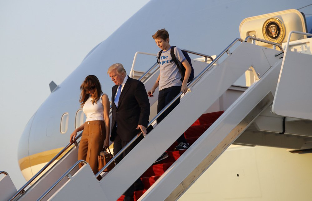 President Trump steps off Air Force One with first lady Melania Trump, left, and son Barron after arriving at Andrews Air Force Base, Md., on Sunday. Trump returned to Washington after spending the weekend at Trump National Golf Club in Bedminster, N.J.
