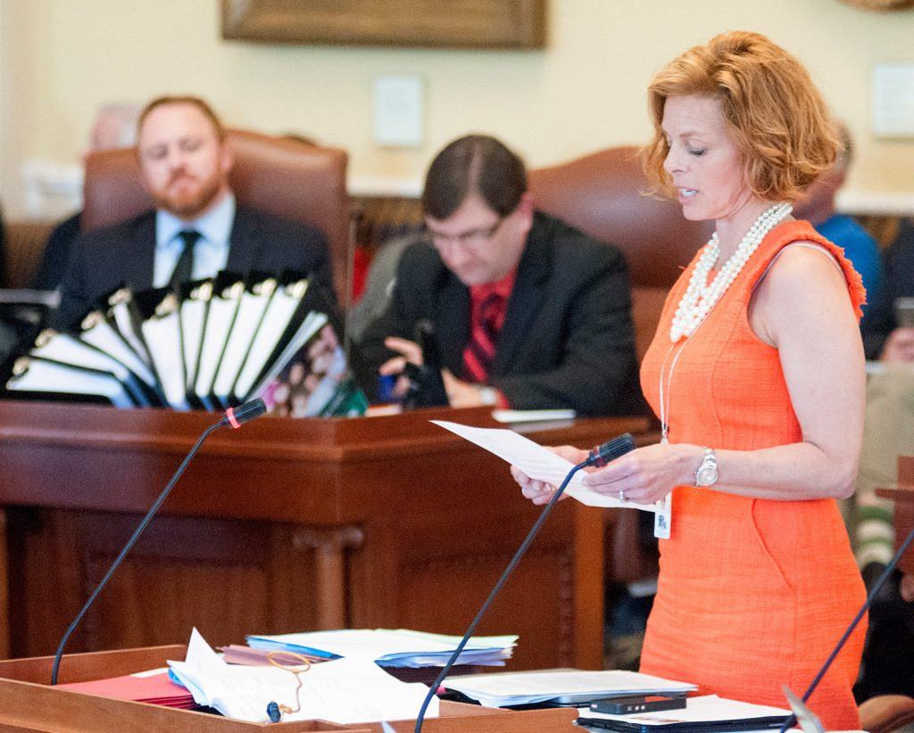 Sen. Amy Volk, R-Scarborough, reads testimony during Wednesday's debate from several waitresses who said their wages with tips were $20 to $30 an hour but without the tip credit their incomes were declining.