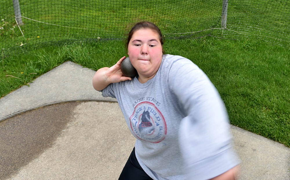 Waterville thrower Sarah Cox prepares to heave the shot put during practice Wednesday.