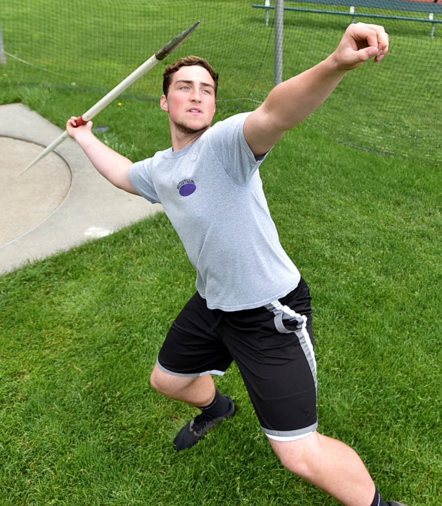 Waterville's Zack Smith throws the javelin during practice Wednesday at the high school.