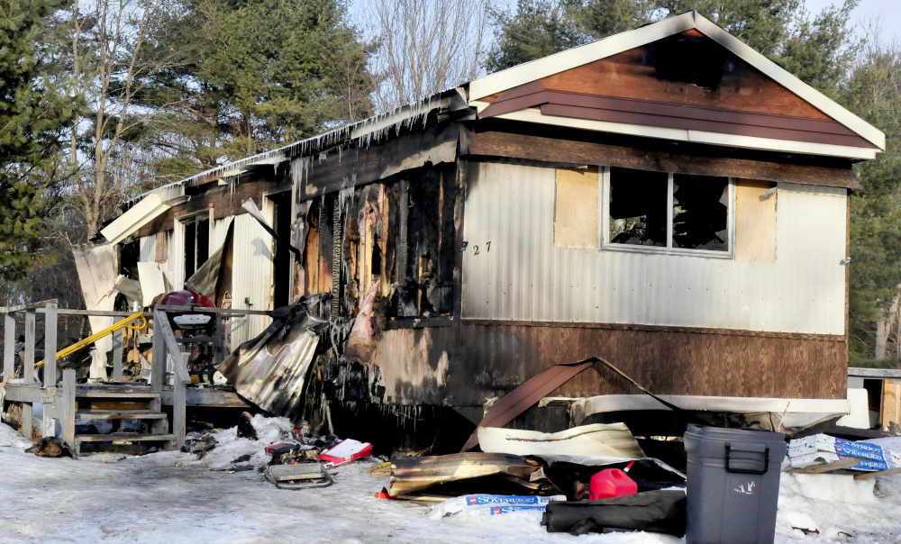 A fire ripped through this mobile home on Feb. 4, 2017, on Browns Corner Road in Canaan. A fundraiser is being held Sunday in Winslow to benefit Laura Dudley, who escaped from the home with her two dogs, but her cat perished in the blaze.