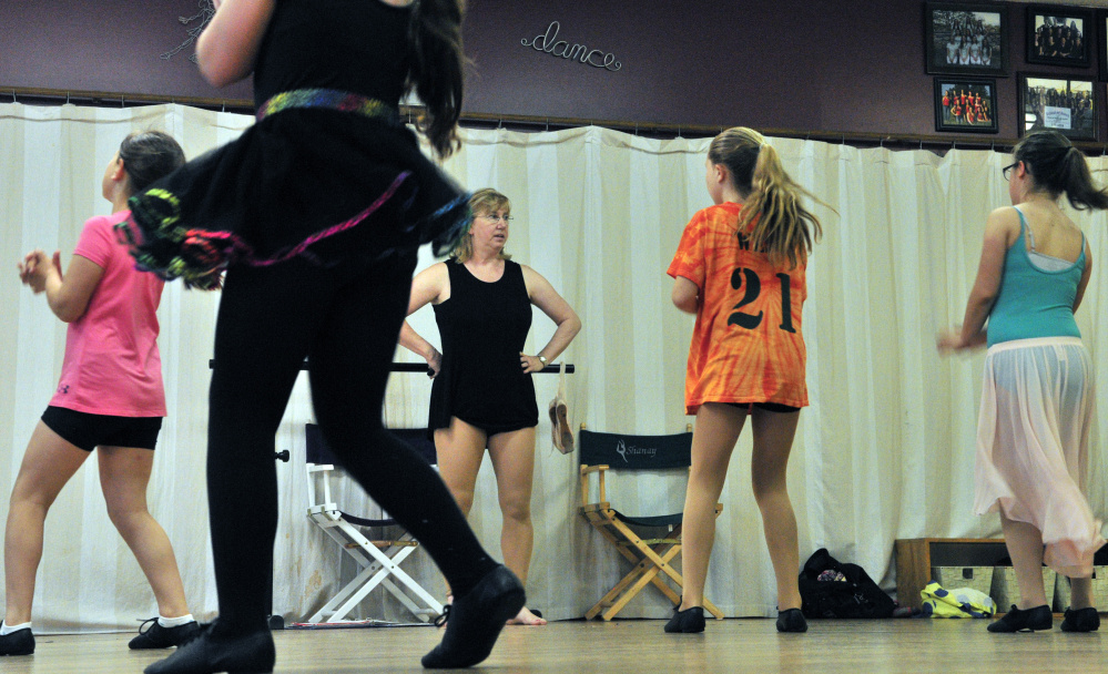 Vicki Gilbert watches dancers in a third-and-fourth-grade jazz dance class Thursday at Vicki's School of Dance in Hallowell. She has been running the business for 40 years.