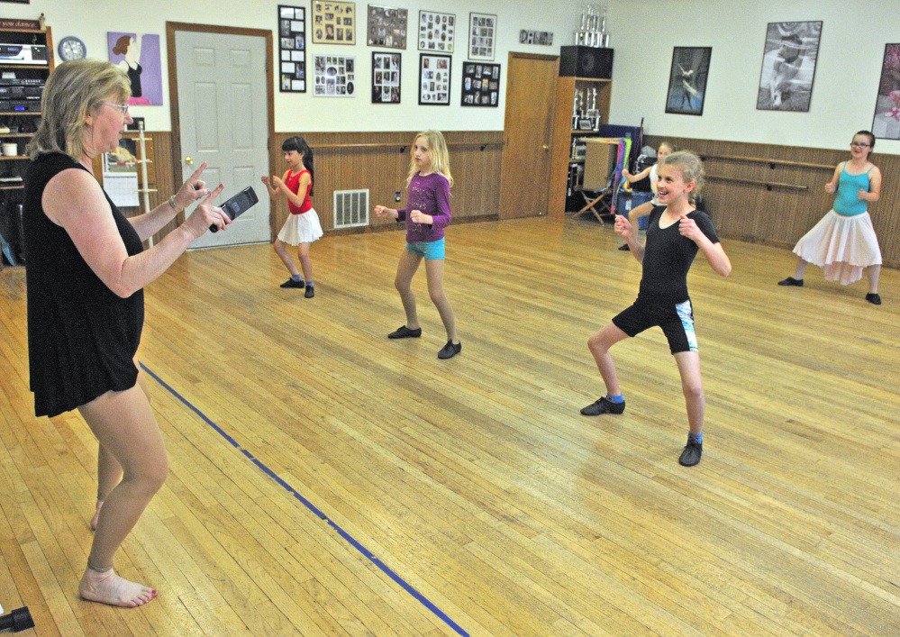 Vicki Gilbert cues dancers in a third-and-fourth-grade jazz dance class as they rehearse for her studio's 40th annual recital Thursday at Vicki's School of Dance in Hallowell. She has been running the business for 40 years.