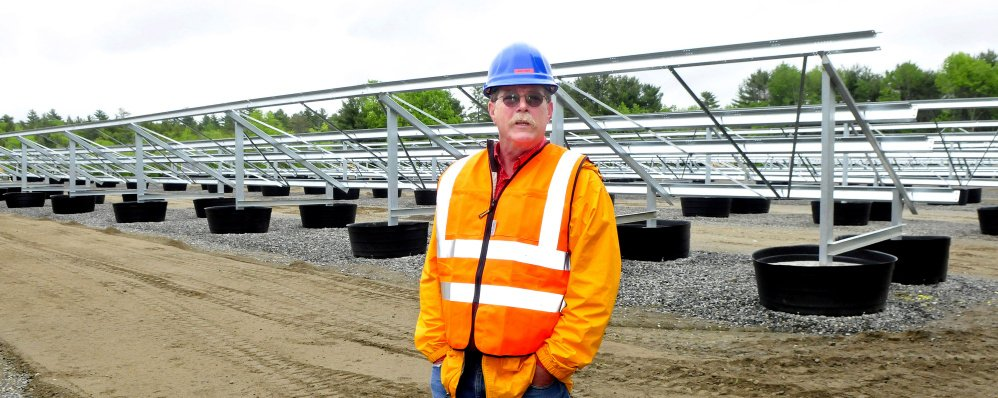 Gus Libby, assistant director of Operations at Colby College, expects the new solar facility under construction near the Waterville campus on Monday will be producing energy sometime this fall if the weather cooperates.