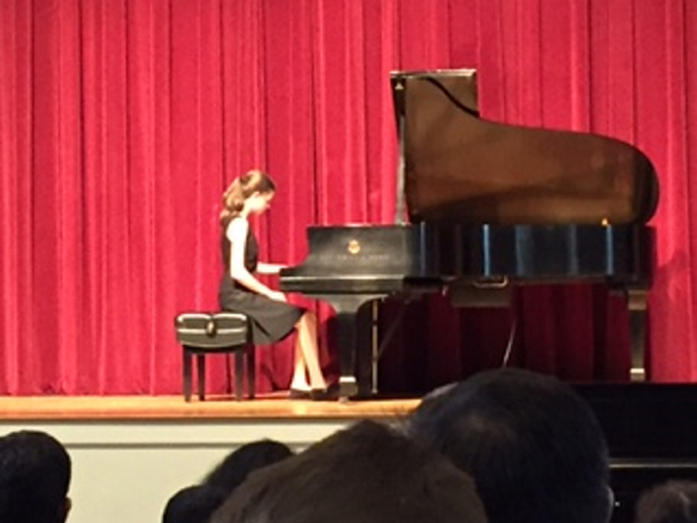 Inga Zimba, an eighth grader at Waterville Junior High School, at the piano during the Pine Tree Piano Festival in Bethel. She won third place in the Junior Division.