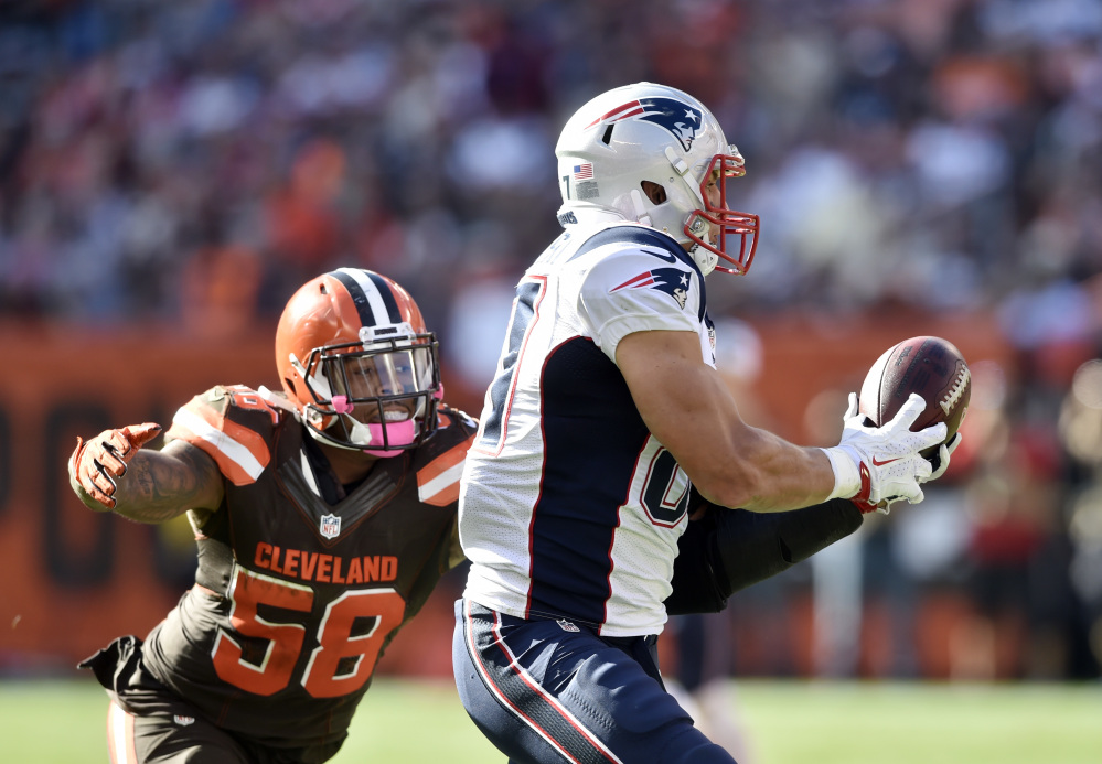 New England Patriots tight end Rob Gronkowski, right, makes a catch against Cleveland inside linebacker Christian Kirksey in the second half of an Oct. 16 game last season.