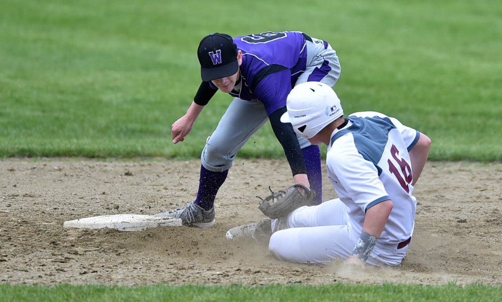 Waterville's David Barre tags out Foxcroft runner Ryan Vienneau at second base  during a Class B North prelim game Tuesday