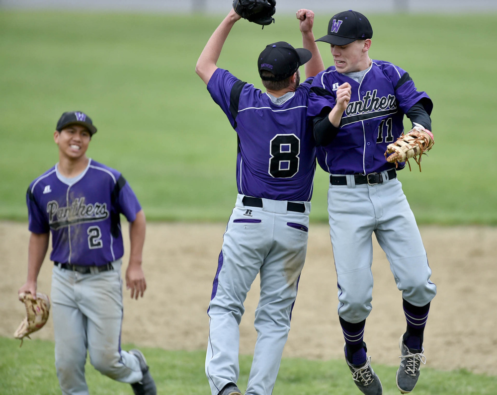 Waterville teammates Cody Pellerin (8) and Jackson Aldrich (11) celebrate after they sank Foxcroft Academy 3-0 in a Class B North prelim game Tuesday.