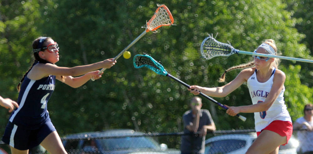 Messalonskee's Ally Turner fires a shot on net as Portland's Morgan Kierstead defends during the first half of a Class A North girls lacrosse quarterfinal Wednesday at Thomas College.