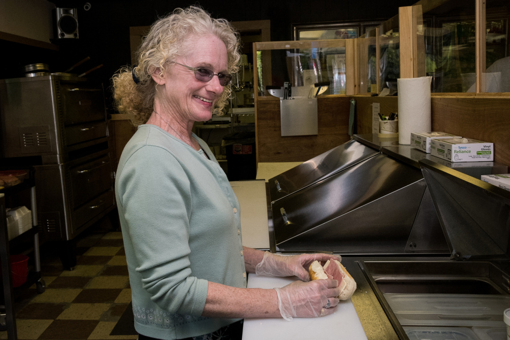 Jewell's Market on Main Street in Readfield features homemade food, pizza and submarine sandwiches. Owner Sherri Jewell is shown here Wednesday making a ham sandwich.