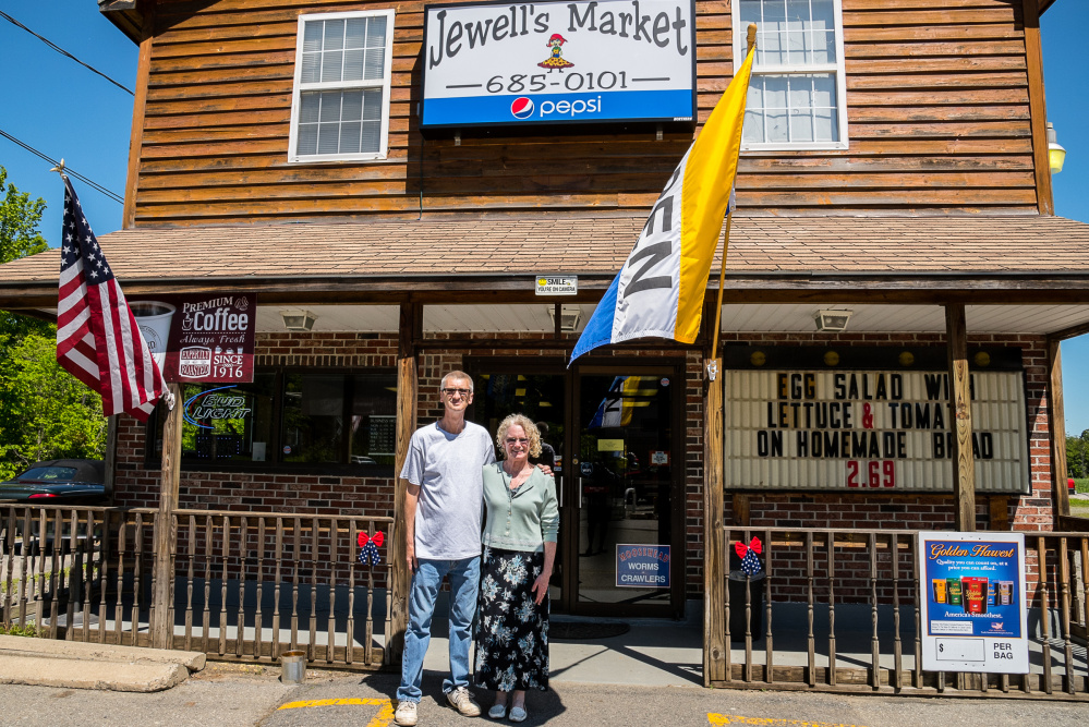 Fred and Sherri Jewell, the new owners of Jewell's Market on Main Street in Readfield, stand in front of their newly opened store on Wednesday.