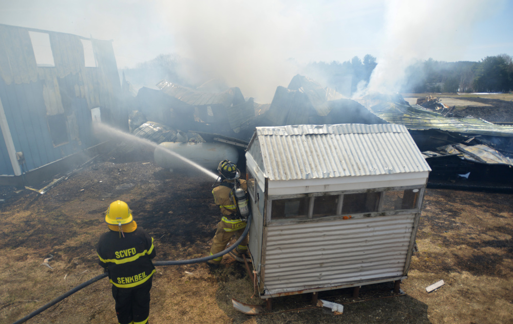 Firefighters from Weeks Mills, China, South China and Windsor battle a structure fire April 15 on Neck Road in South China. China selectmen at a Thursday morning meeting voted to pay officers stipends and emergency responders an hourly wage.