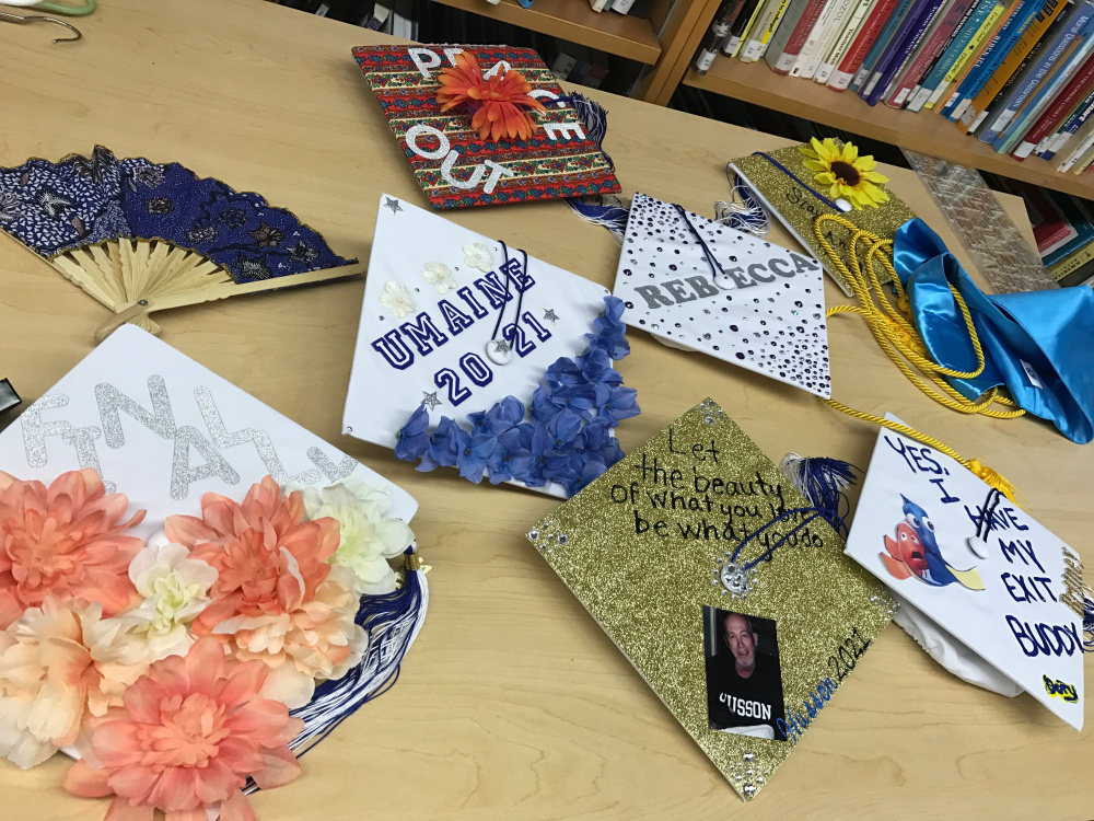 Some Mt. Abram graduates showed off their decorated mortarboards before commencement at Mt. Abram High School on Friday night.