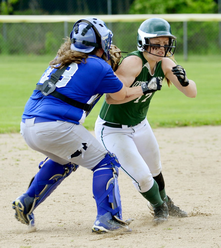 Lawrence catcher Haley Holt attempts to run down Oxford Hills runner Hannah Kenney between second and third base in the sixth inning of a Class A North semifinal game Saturday in South Paris.