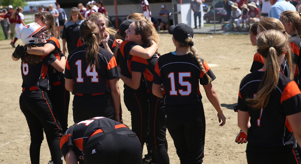 The Skowhegan softball team celebrates its victory over Bangor in a Class A North semifinal game Saturday.