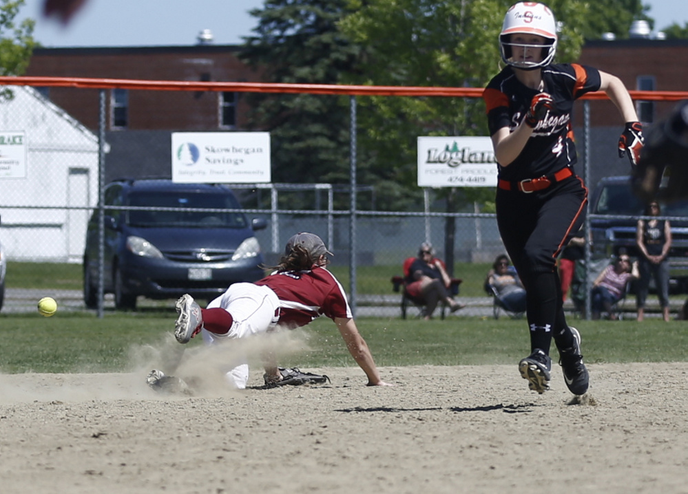 Bangor shortstop Emma Payne can't get to this grounder as Skowhegan runner Sydney Reed bolts for third base during an A North semifinal game  Saturday. The Indians will play Oxford Hills in the regional final.