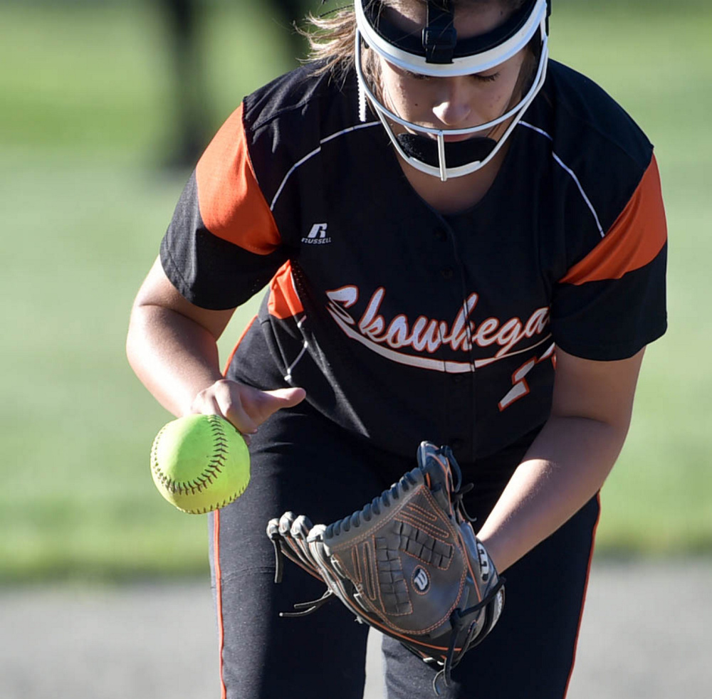 Skowhegan's Lindsey Warren tries to get a hold of a grounder during the Class A North title game Wednesday night in Augusta.