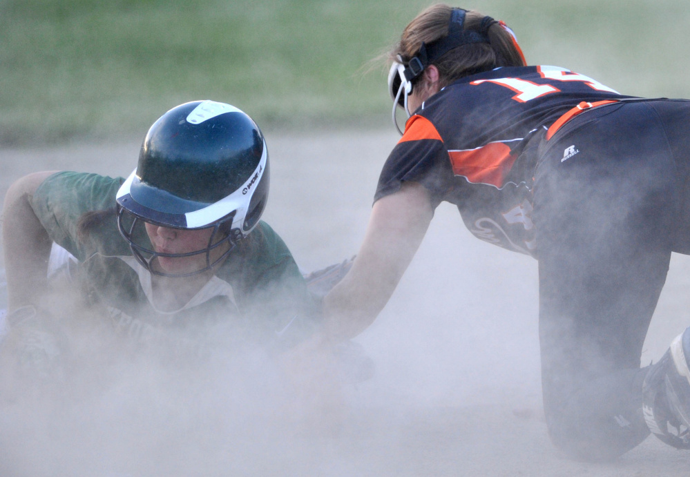 Oxford Hills runner Madison Day slides safely into third base before Skowhegan infielder Lindsey Warren can apply the tag during the Class A North title game Wednesday night in Augusta.