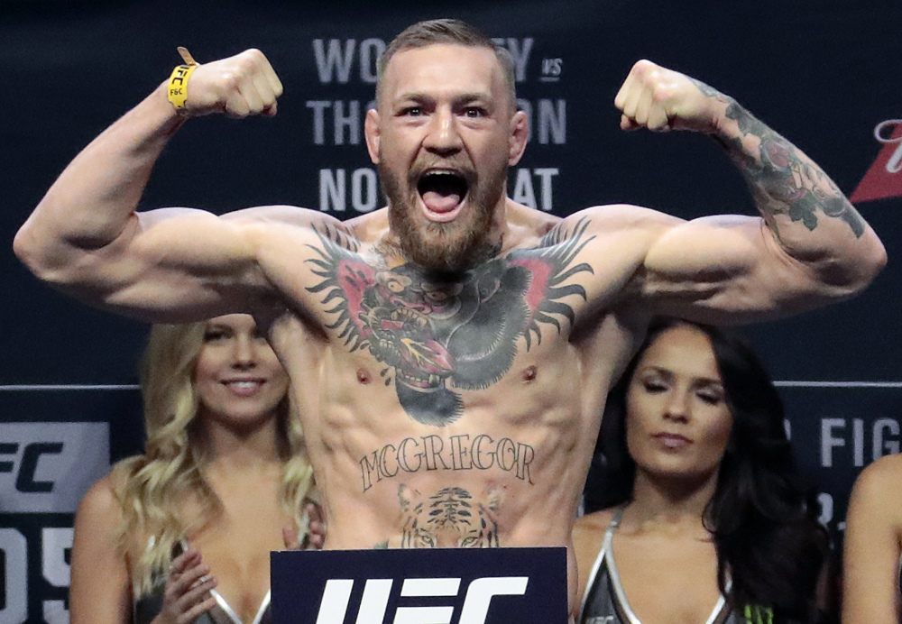 In this Nov. 11, 2016 photo, Conor McGregor stands on a scale during the weigh-in event for his fight against Eddie Alvarez in UFC 205 mixed martial arts at Madison Square Garden in New York.
