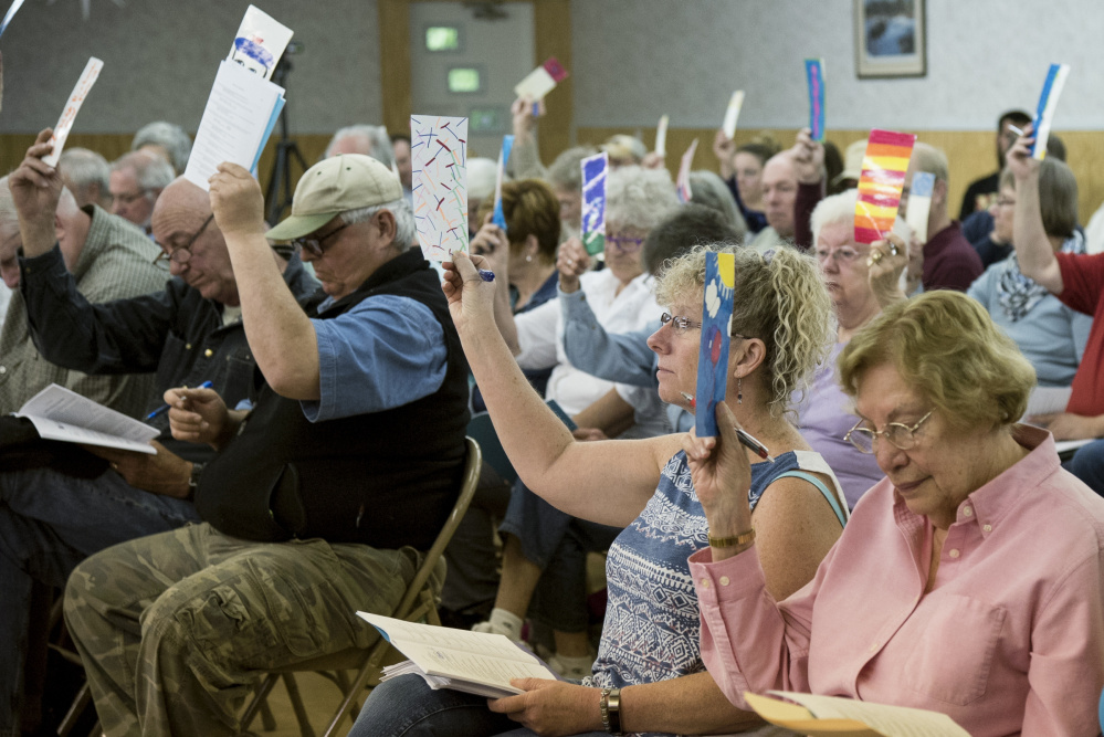 Resident Dick Cutliffe stands and speaks on Saturday during Litchfield's Town Meeting, held at the Sportman's Club.